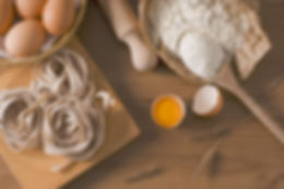 Canva - Ingredients for Pasta on a Woode