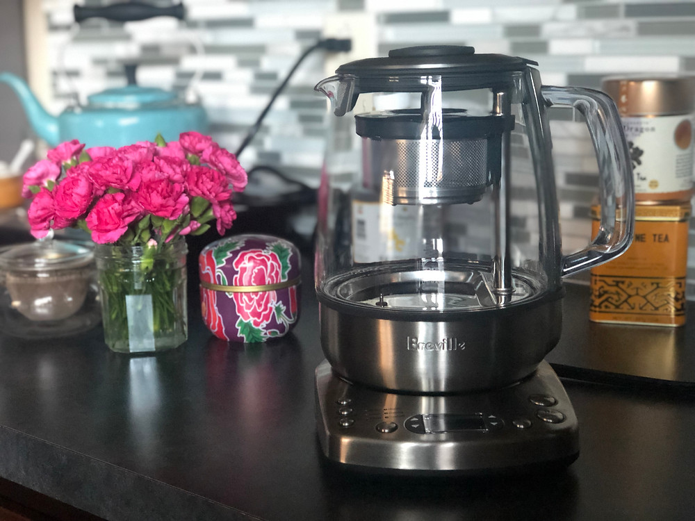 The Breville Tea Maker sitting a-top a cabinet