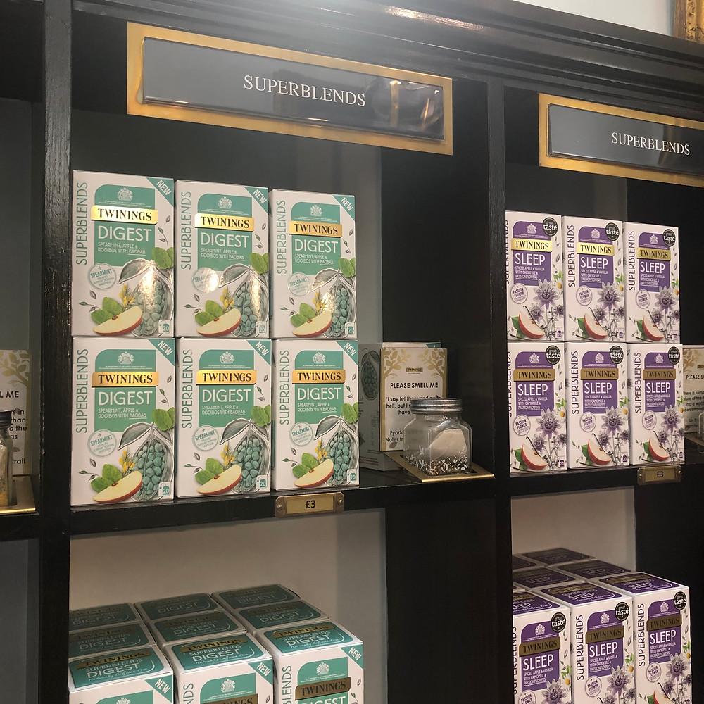 Twinings super blends sitting on a shelf in the Twinings Tea Shop