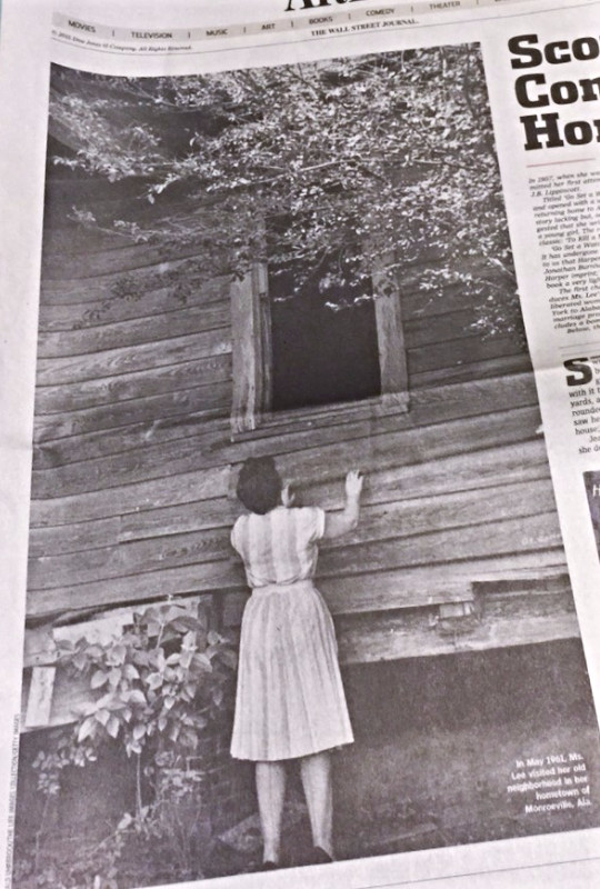 Harper Lee peering into the window of her old house.
