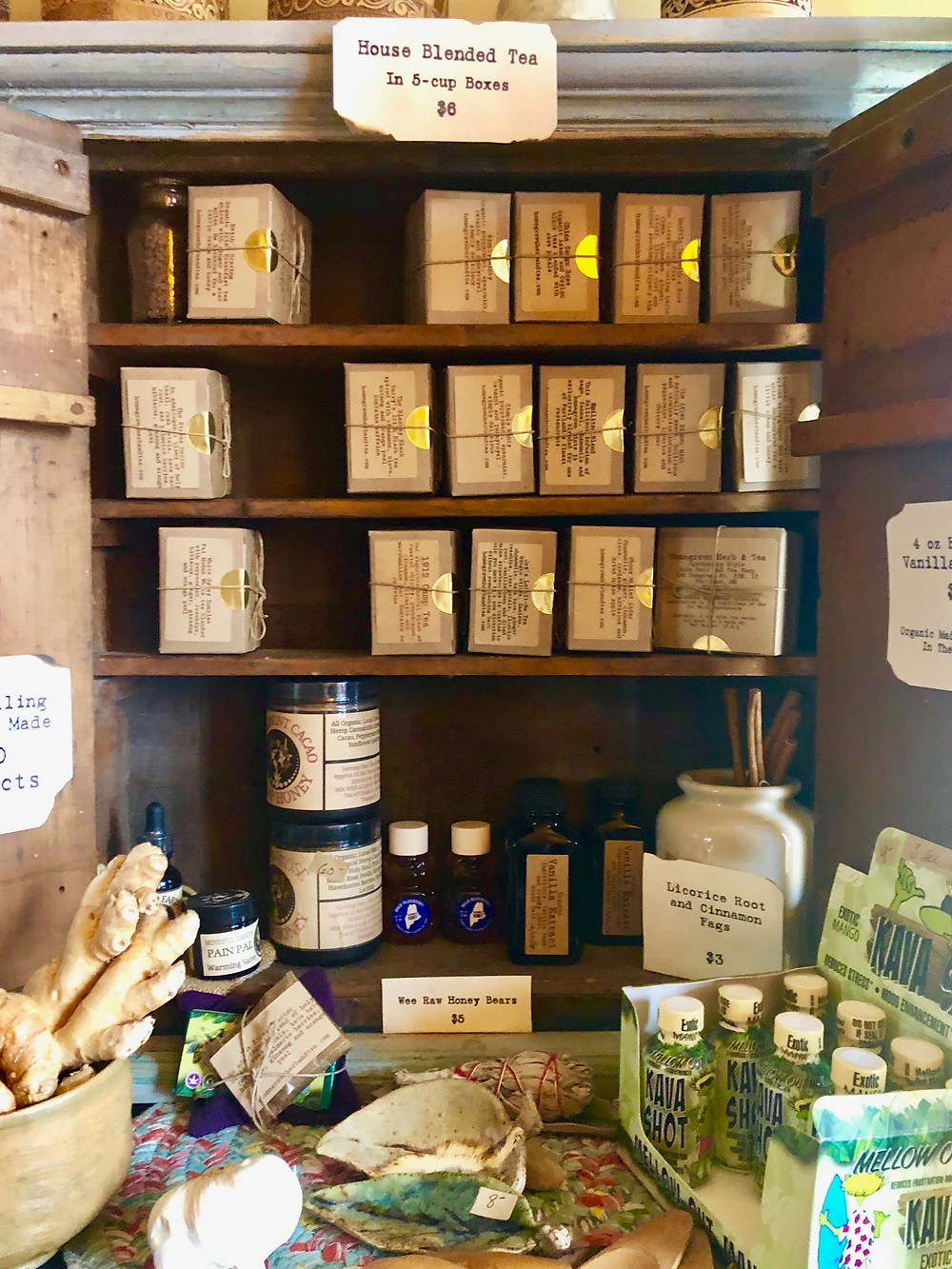 A tea cabinet full of pre-blended tea, essential oils, and other products