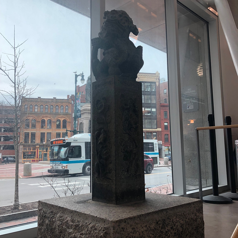 Asian art sculpture in entrance of Portland Public Main Library