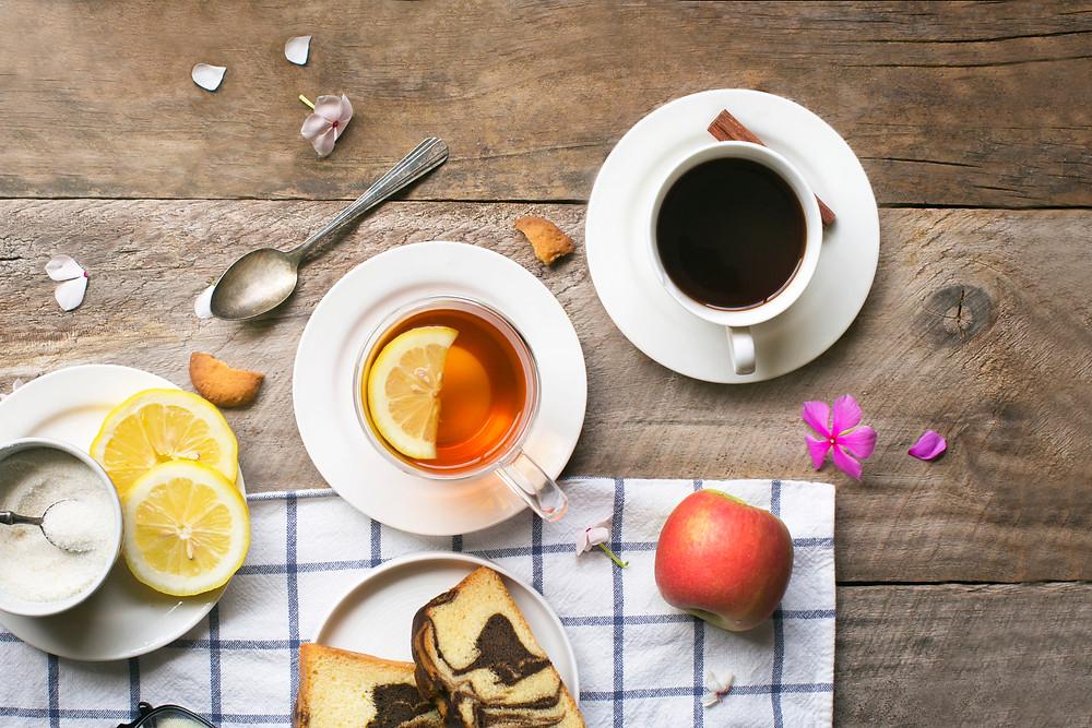 Herbal tea with lemon slice and coffee