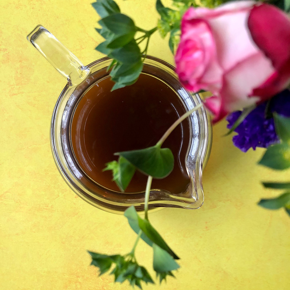 St. John's Wort Tea in a tea cup with flowers