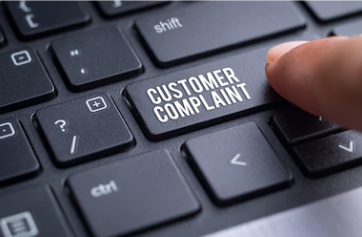 """""""Customer Complaint"""" as the """"Enter"""" button on a black keyboard with an index finger"""