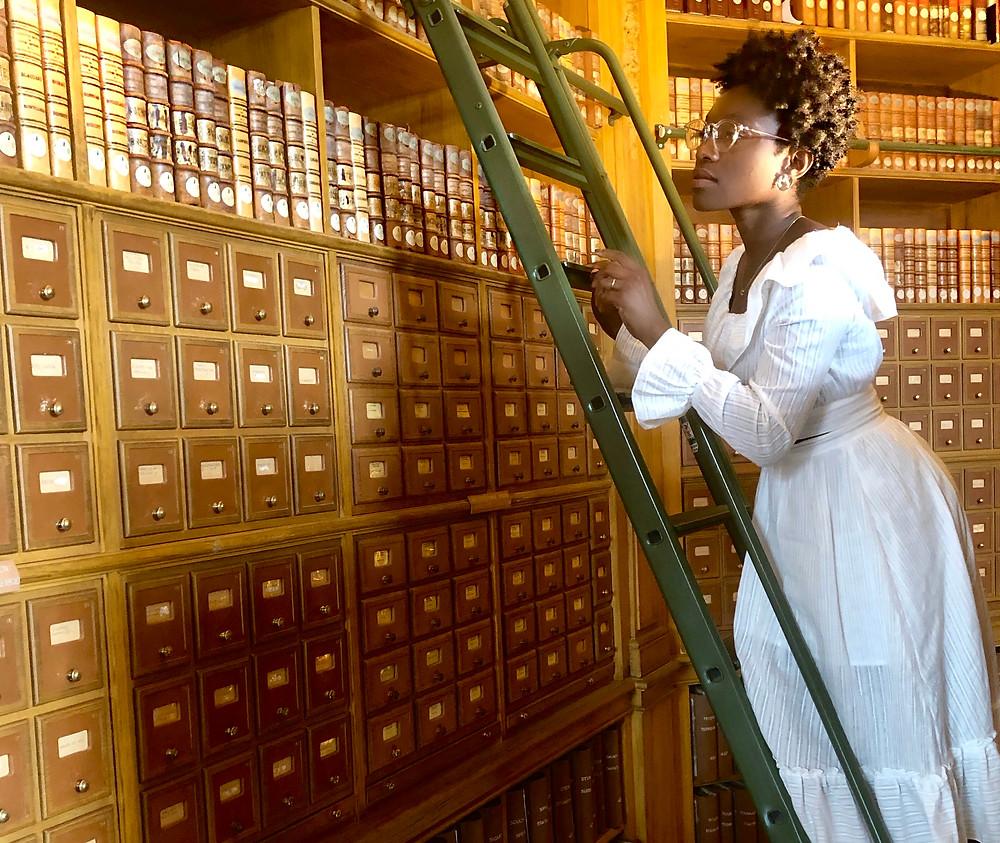 Gabie on a green ladder in The Mazarin Public Library
