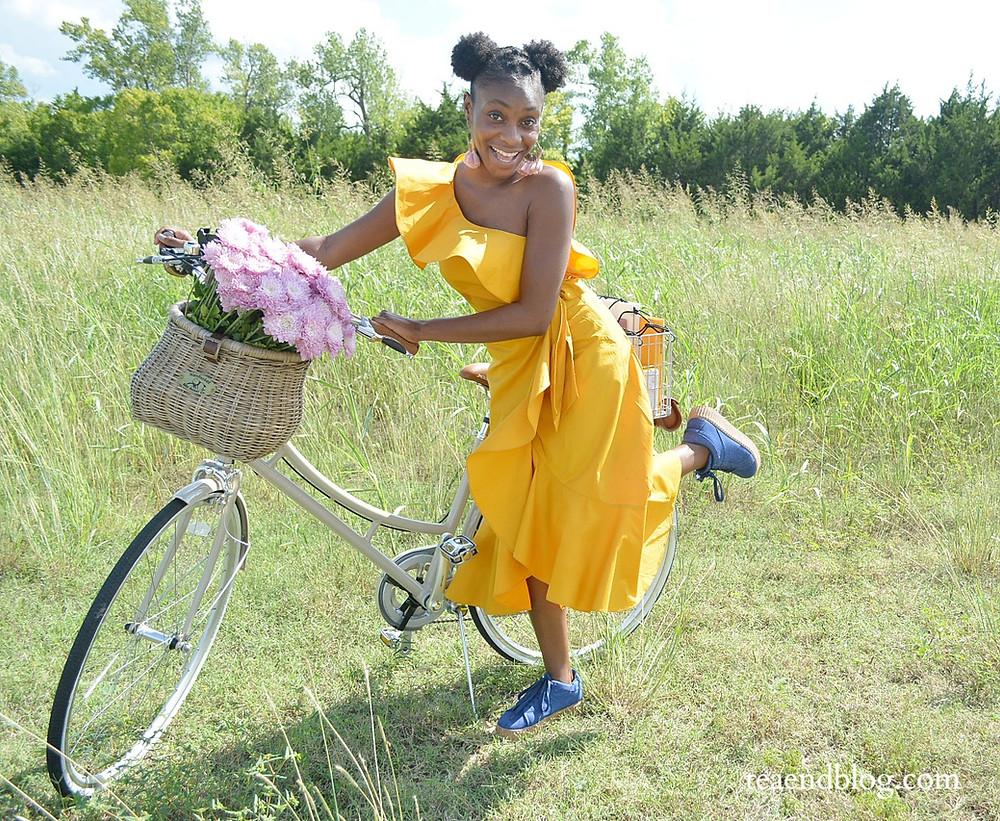 Gabie joyfully beside her dream bike