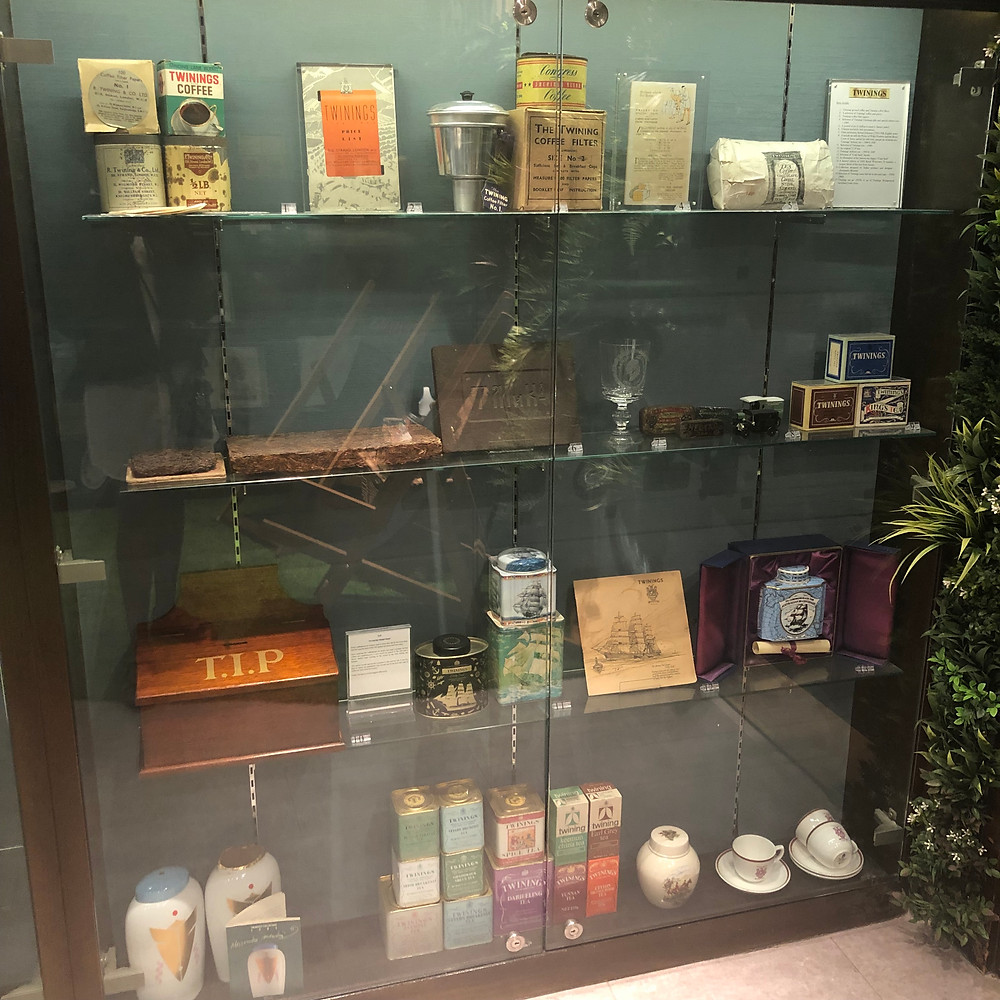 Display vintage pieces behind glass within the Twinings Museum