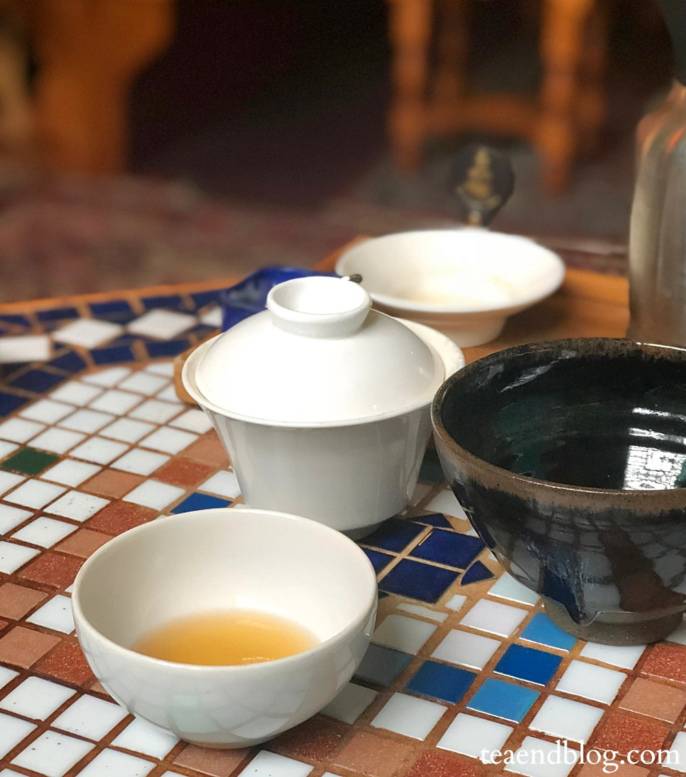 Dobrá Tea | Pittsburgh, PA | gaiwan filled with oriental beauty tea leaves, a small white tea cup and a matcha bowl