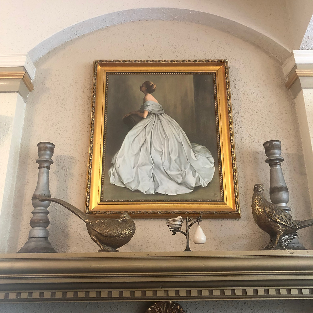 Painting above mantel of fireplace in Potpourri of Silk