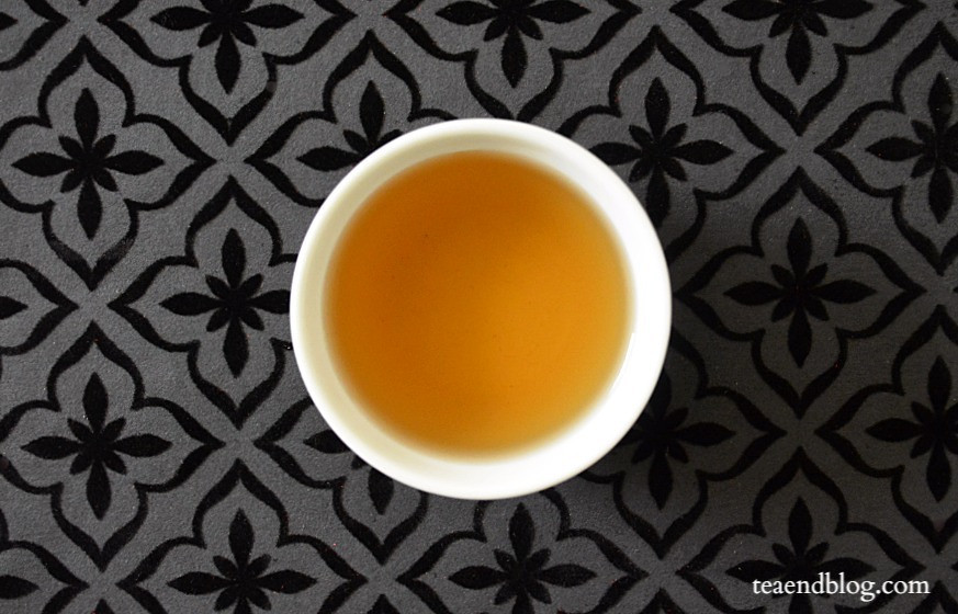 Aerial view of Dream On Tea by K&G Blended in a white cup with black textured background