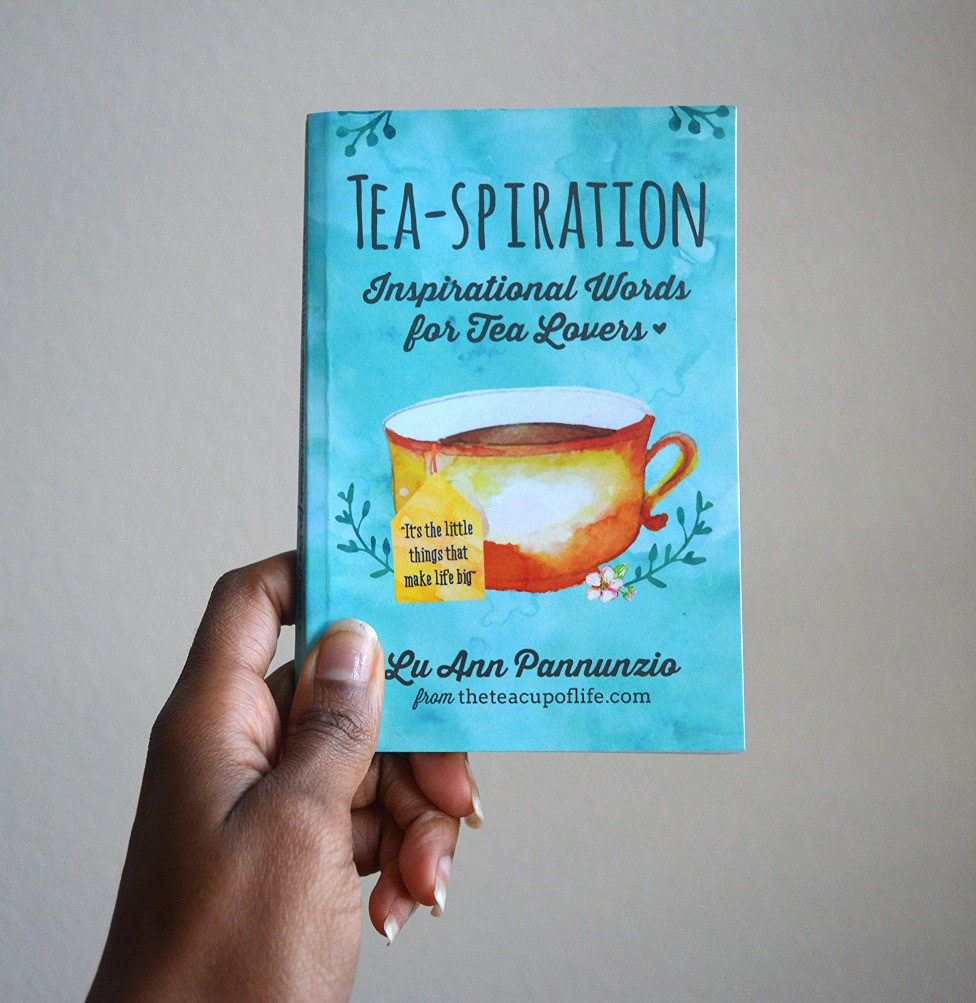 Book Review | Gabie holding a copy of Tea-spiration by LuAnn Pannunzio
