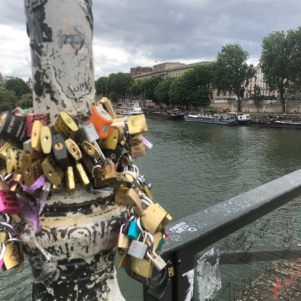 Pont des Arts 'love locks' - a tourist tradition of attaching locks to the bridge as a symbol of affection
