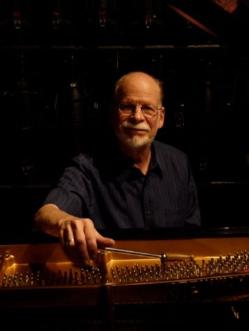 Photo of Allan H. Day, piano tuner onstage at Flynn Center for the Performing Arts in Burlington, Vermont