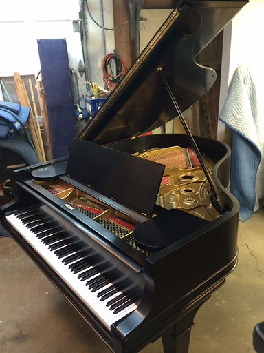 Rebuilt and refininshed grand piano by Allan H. Day, RPT