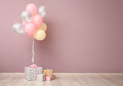 Colorful air balloons and gift boxes nea