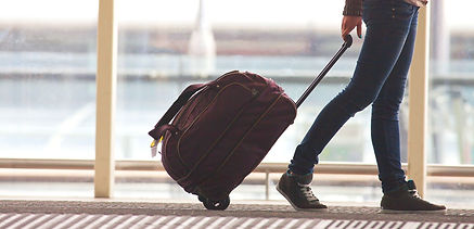 Person%20Rolling%20Suitcase%20in%20Airpo