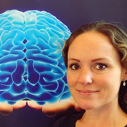 Anne Allen Havening and NLP Master Practitioner creator of Perform At Your Peak Therapy with an image of the brain.