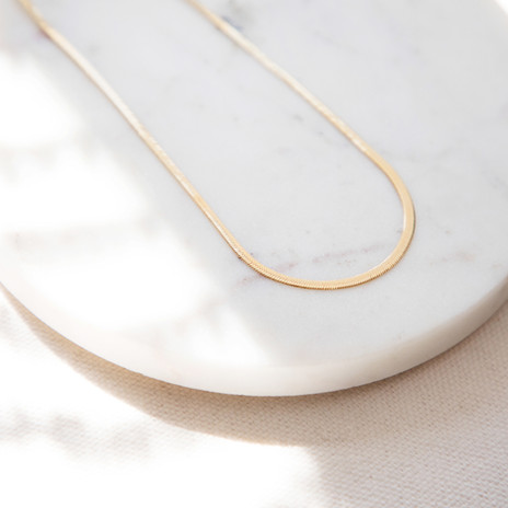 Gold Necklace on Marble Surface, Jewelle