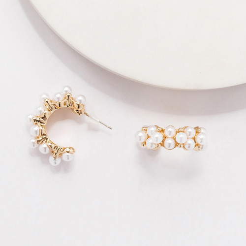 Wholesale gold and pearl earring Photogr