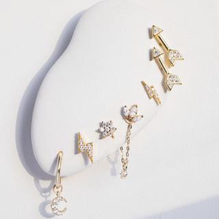 Gold earrings, cuffs, conch, helix.jpg