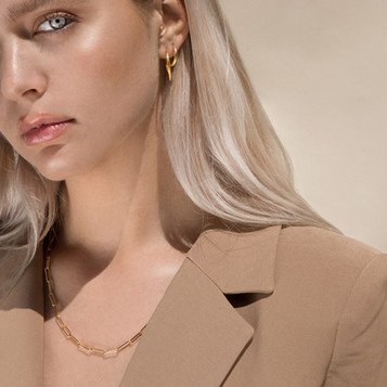 Model Wearing Gold Necklace And Earrings