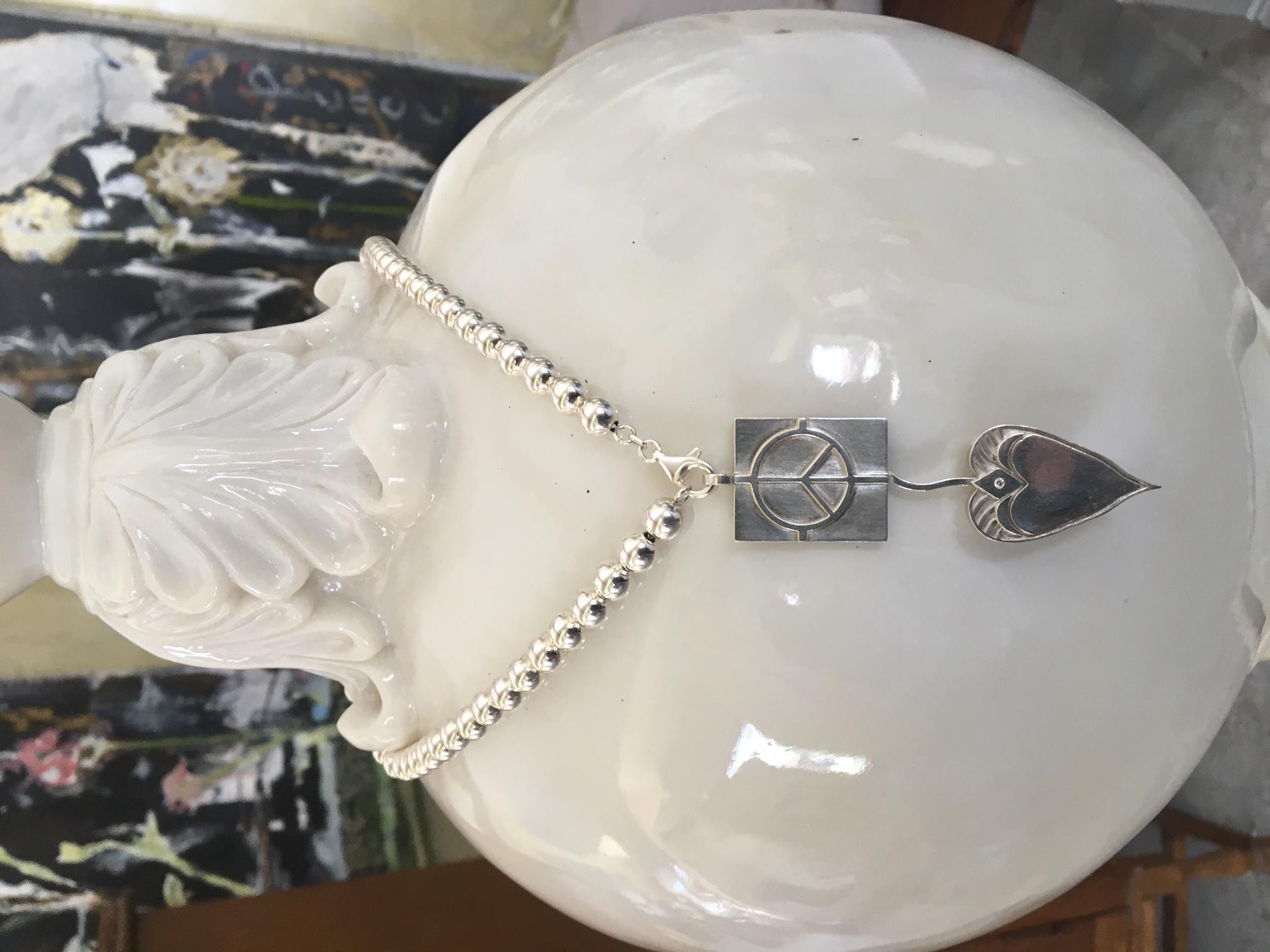 Smooth Pendant with Diamond, $550.