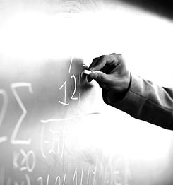 Teacher Writing a Formula on a Blackboard_edited.jpg
