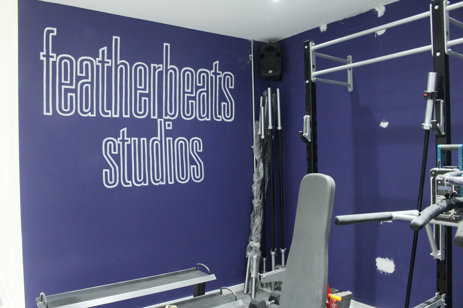 Gym logo hand painted sign on wall