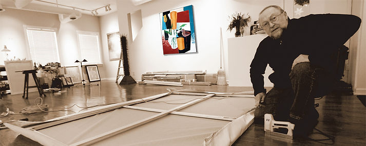 Ed Burke in Peekskill, NY studio stretching canvas for Early Spring painting