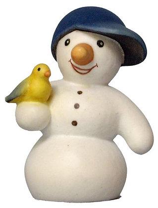 Schneemann aus Holz mit Vogel