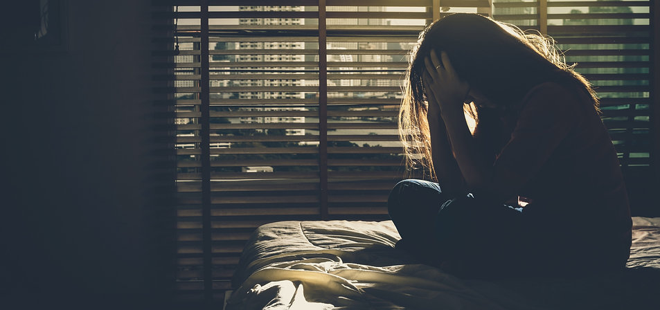 depressed%20Women%20sitting%20head%20in%