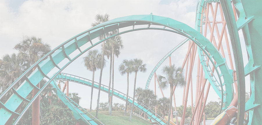Green and coral roller coaster around palm trees