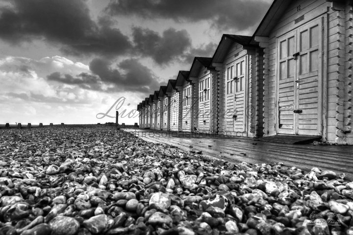 109E1BW Eastbourne Beach Huts at Sunset