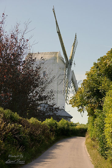 420D White windmill on a hill with a country lane