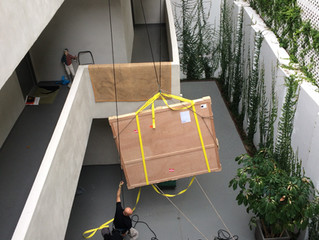 Custom Oversize art hoisted 4 stories for installation by Art Installation Remedies
