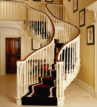 Bespoke Curved Staircase with a Walnut Handrail