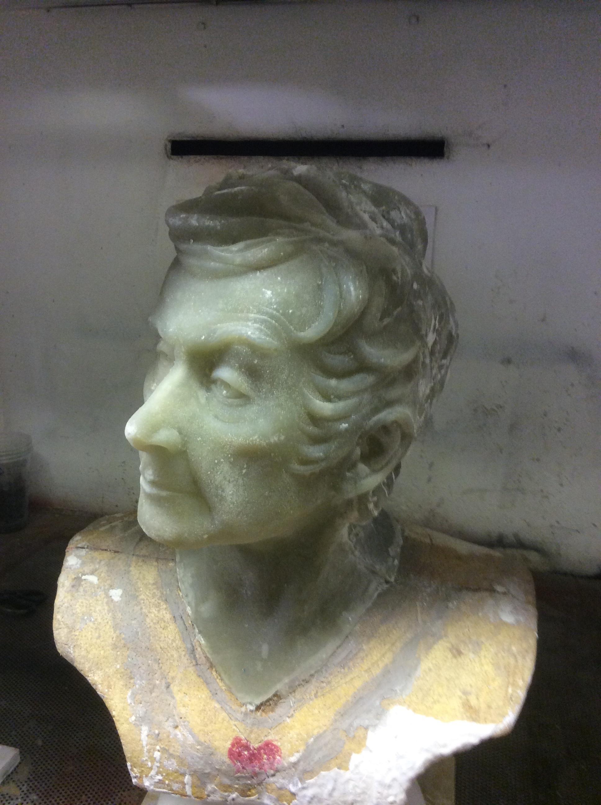 Fibreglass bust, polystyrene base