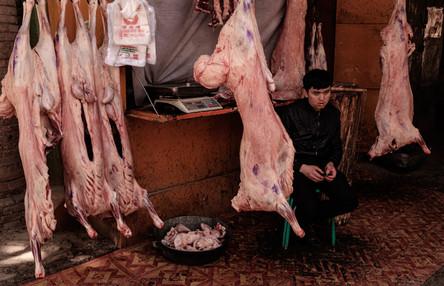 Kashgar. Xinjiang Uyghur. Butcher in street