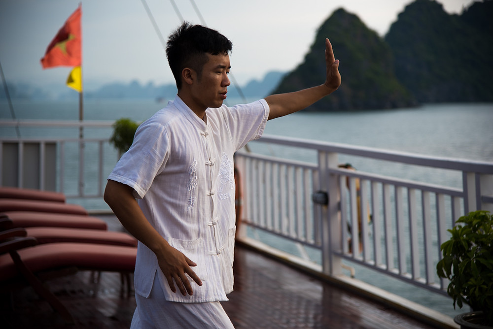 taichi on sundeck indochinasails halong bay