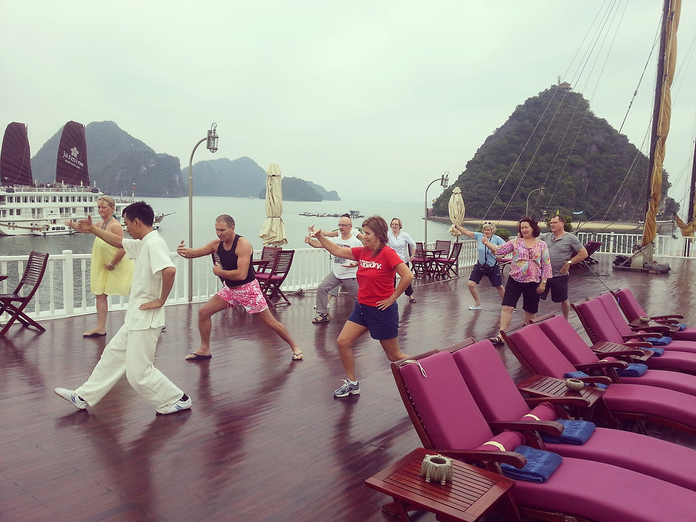 taichi on sundeck Indochina Sails Halong Bay