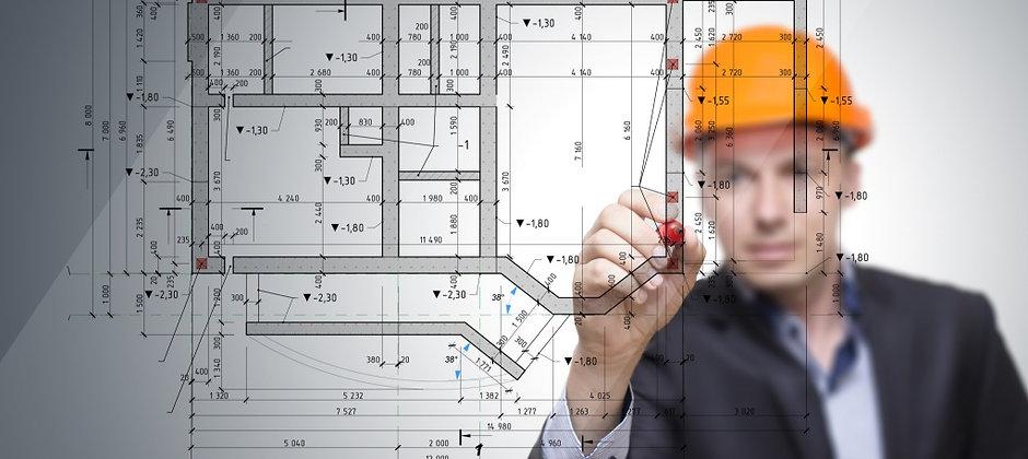 engineer-in-hard-hat-drawing-plans.jpg