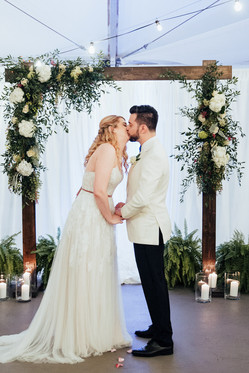 first kiss with bride and groom during ceremony