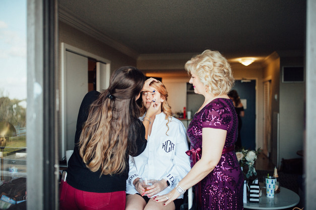 bride getting ready for wedding with mom
