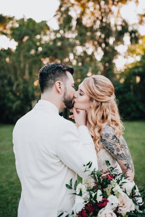 bride and groom kiss pose
