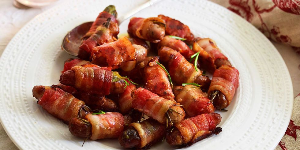 Pigs in blankets on a plate.