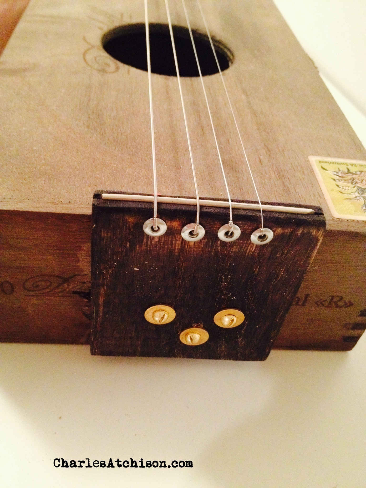 relic style cigar box guitar