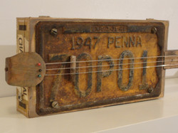 1947 License plate cigar box guitar