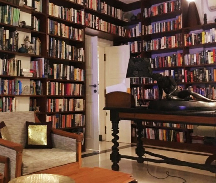 """""""full of art works, antiques, and a library that has shelves and shelves of books."""""""