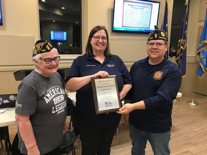 """Help USA Troops presents an award to Post 690 for their efforts in providing """"care"""" packages to troops in Afghanistan and Iraq."""